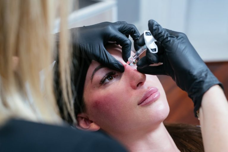 dr kate performing rhinoplasty with dermal fillers