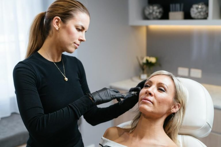 cosmetic nurse shannon performing dermal filler injection